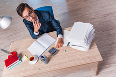 The young businessman in stress with lots of paperwork Royalty Free Stock Image