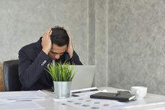 Businessman Stress from problematic work. Young businessman Stress from problematic work Show with the mod Symptoms that indicate stress Stock Image