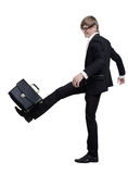 Young businessman strikes foot for the briefcase Stock Photos