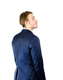 Young businessman or student looking up to a side Stock Photos