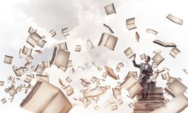 Young businessman or student studying the science and books fly stock image