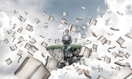 Young businessman or student studying the science and books fly stock images