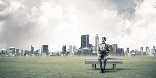 Young businessman or student studying the science and cityscape at background stock photos