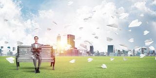 Young businessman or student studying the science and paper planes flying around Royalty Free Stock Images