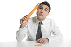 Young businessman student thinking with pencil Stock Photo
