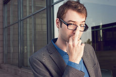 Young businessman subtly showing middle finger Royalty Free Stock Image