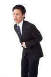 Young businessman suffering from abdominal pain Stock Photos