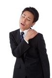 Young businessman suffering from stiff neck. This is a photograph of a young businessman suffering from stiff neck Royalty Free Stock Photography