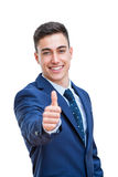 Young Businessman in suit doing thumbs up. Stock Photos
