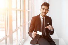 Young businessman in suit with empty visit card Royalty Free Stock Image