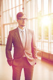 Young businessman in suit and glasses at office Stock Image