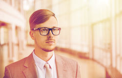 Young businessman in suit and glasses at office Royalty Free Stock Photo