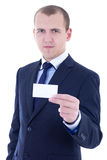 Young businessman in suit holding business card isolated on whit Royalty Free Stock Image