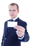 Young businessman in suit holding business card isolated on whit Royalty Free Stock Photo