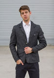 Young businessman in suit outside. Confident young businessman guy in suit outdoors stock photos