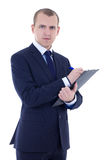 Young businessman in suit with pen and clipboard isolated on whi Royalty Free Stock Photo