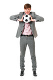 Young businessman in suit with soccer ball Royalty Free Stock Photo