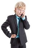 Young businessman in suit talking with mobile phone, isolated white background Stock Photos