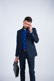 Young businessman in a suit talking on the phone Stock Photo