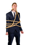 Young businessman in a suit tied up. With rope Royalty Free Stock Photography