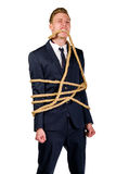 Young businessman in a suit tied up Stock Photo