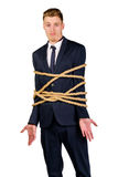 Young businessman in a suit tied up Stock Images