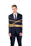 Young businessman in a suit tied up Stock Photography