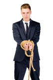 Young businessman in a suit tied up Royalty Free Stock Photos
