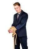 Young businessman in a suit tied up Royalty Free Stock Images