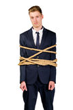 Young businessman in a suit tied up Stock Photos