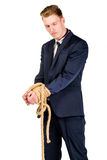 Young businessman in a suit tied up Stock Image