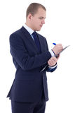 Young businessman in suit writing something in clipboard isolate Stock Photos