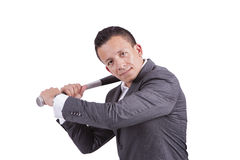 Young businessman swinging baseball bat Stock Image