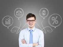 Young businessman and symbols Stock Image