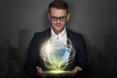 Young businessman with a tablet on his hand Royalty Free Stock Images