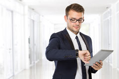 Young businessman with a tablet on his hand Stock Image