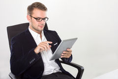Young businessman with a tablet on his hand Royalty Free Stock Photos
