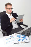 Young businessman with a tablet on his hand Royalty Free Stock Photo