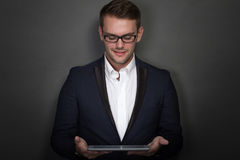 Young businessman with a tablet on his hand Stock Photos
