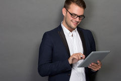 Young businessman with a tablet on his hand Stock Photo