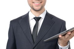 Young businessman with tablet. Isolated on white Royalty Free Stock Image