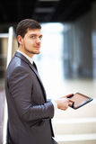 Young businessman with a tablet pc Royalty Free Stock Photos