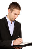 Young businessman taking notes Stock Photography
