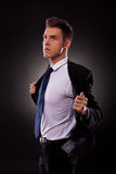 A young businessman taking off his jacket Royalty Free Stock Photography