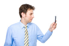 Young businessman taking photo with his smartphone Royalty Free Stock Photo