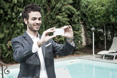 Young Businessman Taking Photos with Mobile Stock Image