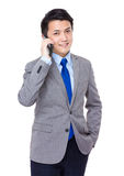 Young businessman talk to cellphone Royalty Free Stock Photos