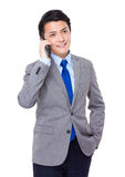 Young businessman talk to cellphone Stock Image