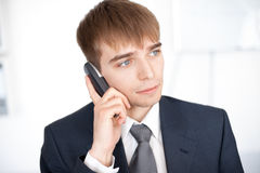 Young businessman talking on cell phone Royalty Free Stock Photos