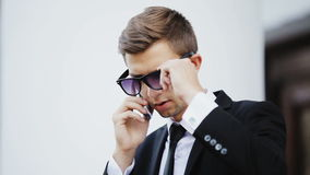 Young businessman talking on cell stock footage